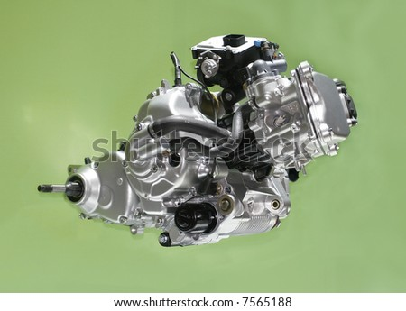 Brand new motorcycle engine isolated over green - stock photo