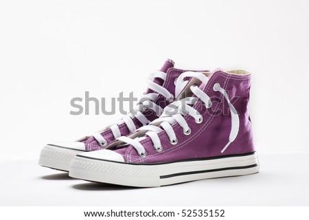 brand new purple sneakers - stock photo