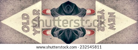 Brand new red shoes from above standing on old and new year sign - stock photo