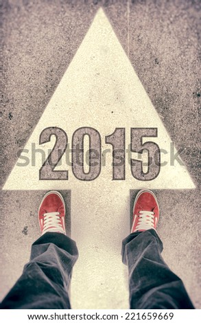 Brand new red shoes from above standing on 2015 sign - stock photo