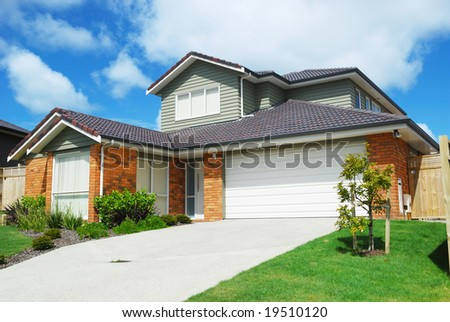 Brand new show home with landscaped front yard - stock photo