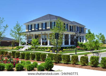 Brand New Suburban American Dream Home with Large Front Porch - stock photo