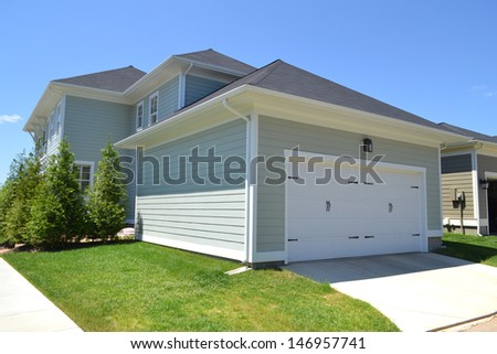 Brand New Suburban American House with Attached Two-Car Garage - stock photo