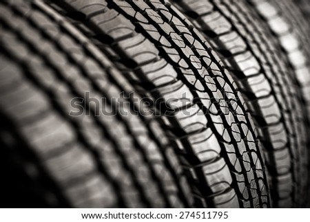 Brand New Tires For Sale. Car Tires Row on a Rack.