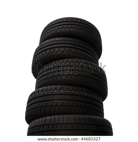 Brand new tires stacked up and isolated on white background - stock photo