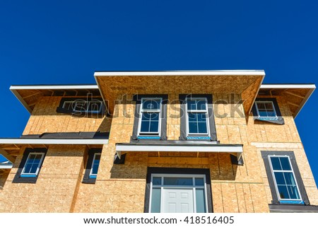 Brand new townhouses building under construction on sunny day in British Columbia, Canada. - stock photo