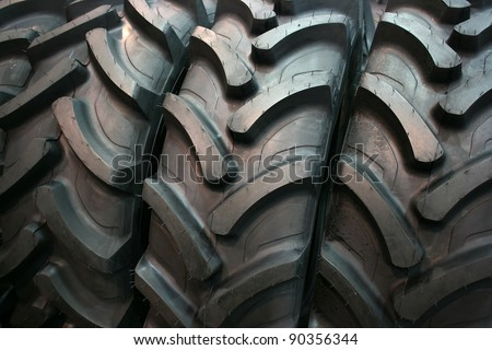 Brand new tractor tires placed on factory floor ready to be transported to tiers shop - stock photo
