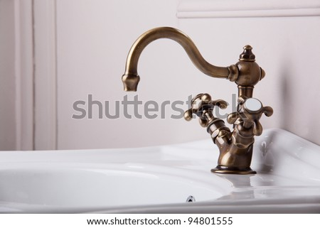 Brand new water tap on bright background - stock photo