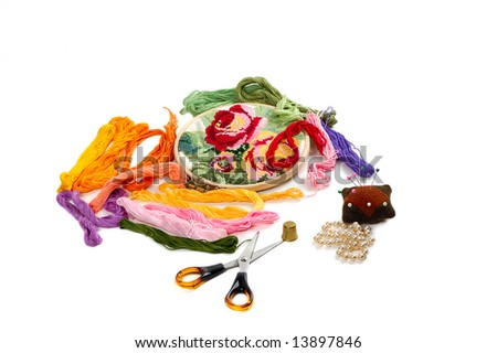 brand of colour threads,needle cushion,pins,tambour and another stuff  for embroidery - stock photo