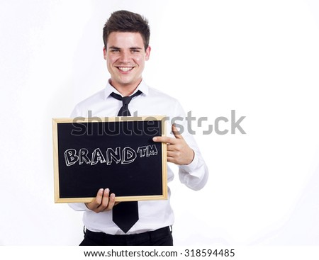 BRAND (tm) - Young businessman holding chalkboard with text