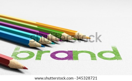 Brand word handwritten on a paper texture with six wooden pencils sourrounding it. Concept image for branding and identity design. - stock photo