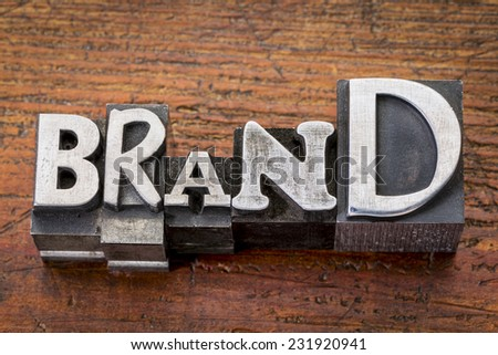 brand word in vintage metal type printing blocks over grunge wood, mixed fonts in style and size - stock photo