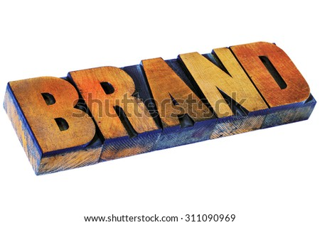 brand word- isolated text in vintage letterpress wood type, stained by color inks - stock photo
