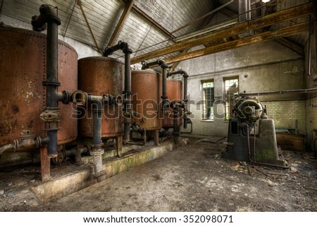 Brandburg, Germany  - May 24, 2010: rusty heating boilers in an abandoned factory in the Brandburg area, Germany - stock photo