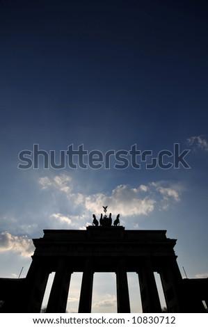 Brandenburg Gate against a dark blue sky - stock photo