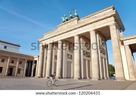 Brandenburg gate, Berlin, cycle passing - stock photo