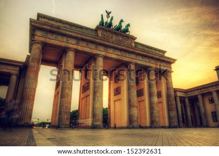 Brandenburg Gate. German Brandenburger Tor in Berlin, Germany. Sunset with beautiful sunbeams - stock photo