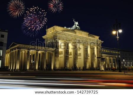 Brandenburg gate illuminated at night in Berlin, Germany, Europe - stock photo