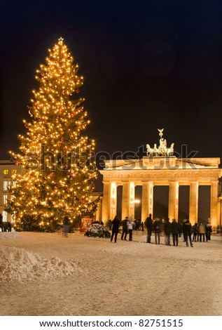 brandenburg gate in berlin at christmas with snow and people - stock photo
