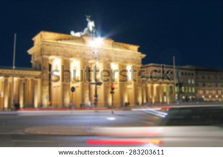 Brandenburg Gate in Berlin, Germany. Blur effect. (Background for tourism leaflets or posters for travelers) - stock photo