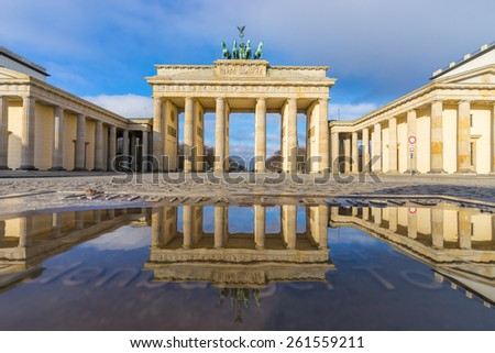 Brandenburg gate in the morning with reflection - stock photo