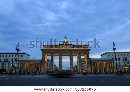 Brandenburg gates in Berlin with crowd and urban transport 