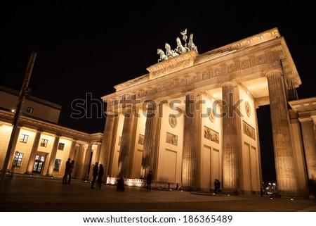 brandenburger gate in berlin by night - stock photo