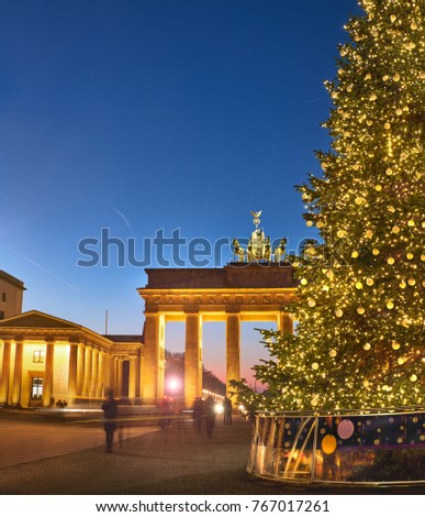 Brandenburger Gate in Berlin with Christmas tree at night with evening illumination, panoramic image