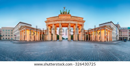 Brandenburger Tor (Brandenburg Gate) panorama, famous landmark in Berlin Germany at night - stock photo