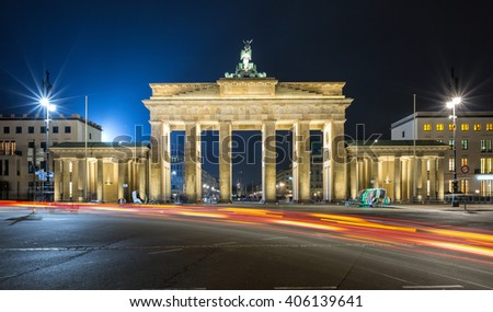 Brandenburger Tor in Berlin, Germany, by night with blurred, red traffic lights