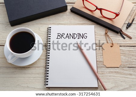 Branding concept with notebook brand tag and product box on work desk