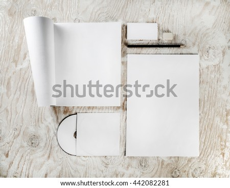 Branding identity set on light wooden background. Blank template for branding identity. Blank stationery set. Template for design portfolios. Top view. - stock photo