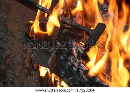 branding irons in campfire - stock photo