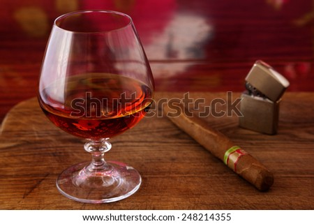 brandy and a cigar for the gentleman - stock photo