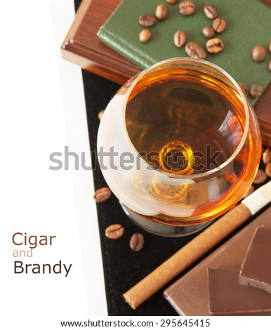 Brandy and cigar isolated on white background with sample text - stock photo