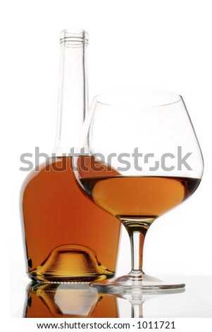 brandy glass and bottle - stock photo