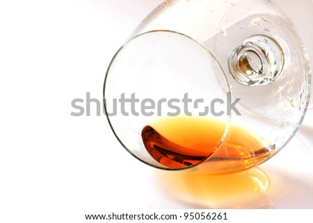 brandy glass lying, white background