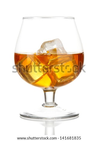 Brandy glass with ice isolated on white - stock photo