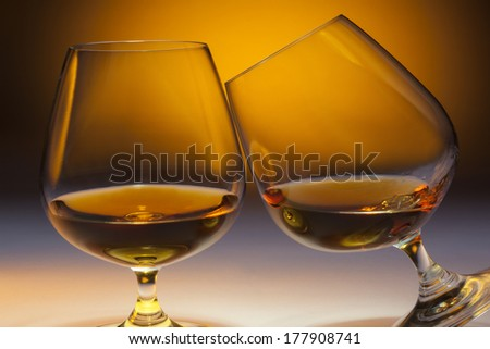 Brandy glasses (brandy snifter). Brandy is a spirit produced by distilling wine and generally contains 35 to ??60% alcohol by volume (70 to??120 US proof) and is often taken as an after-dinner drink. - stock photo