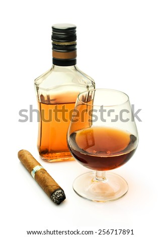 Brandy in a glass and a bottle with a cigar isolated on white - stock photo