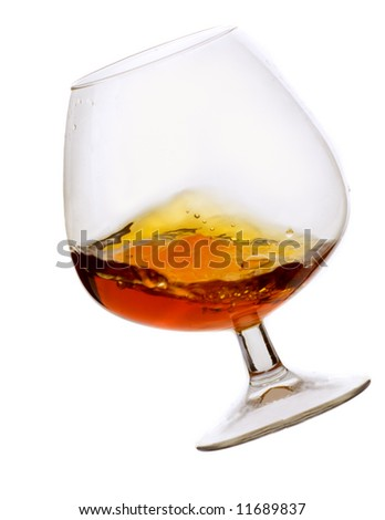 Brandy in glass on the white - stock photo