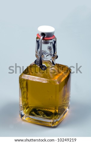 Brandy in old style bottle - stock photo