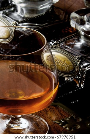 brandy on a wooden surface - stock photo