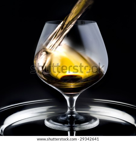 Brandy pouring into a glass
