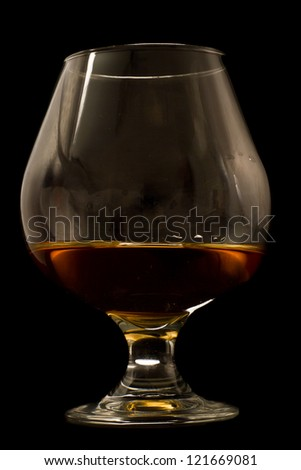 brandy served in a snifter isolated on a black background - stock photo