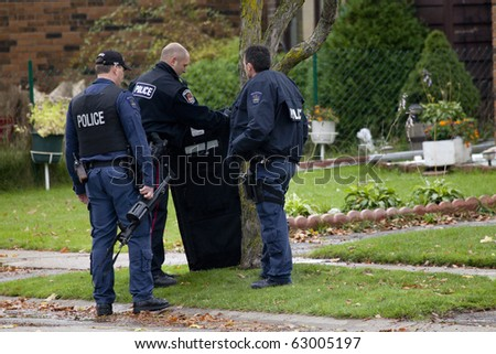 BRANTFORD ON, CANADA-OCT 14:Woman holds a hostage at knifepoint in her home on October 14, 2010 in Brantford ON Canada. . Brantford is a  city west of Toronto and north of Niagara Falls.