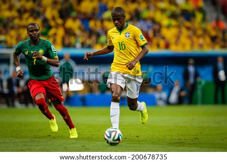 BRASILIA, BRAZIL - June 23, 2014: Brazil player competes for the ball during the World Cup Group A game between Brazil and Cameroon at Estadio Nacional Mane Garrincha. No Use in Brazil.
