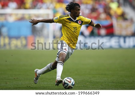 BRASILIA, BRAZIL - June 19, 2014: Cuadrado of Colombia during the game between Colombia and Ivory Coast at Estadio Nacional. No Use in Brazil. - stock photo