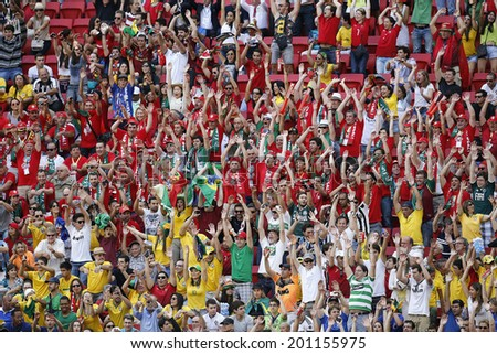 BRASILIA - JUNE 26, 2014: Fans cheering on the FIFA World Cup 2014 Group G match between Ghana and Portugal in Estadio Nacional Mane Garrincha in Brasilia, Brazil. NO USE IN BRAZIL