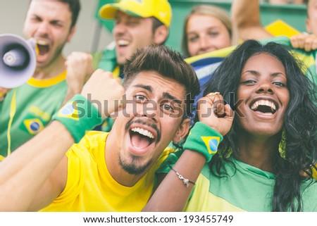 Brasilian Supporters at Stadium - stock photo